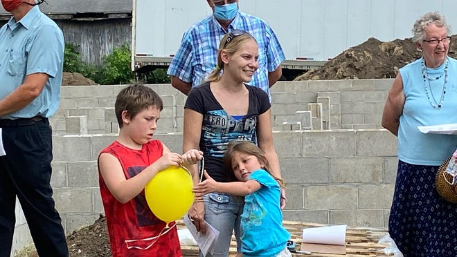 Habitat for Humanity celebrates Nicole White and her family as she will be the owner of the 25th house built in Lincoln.