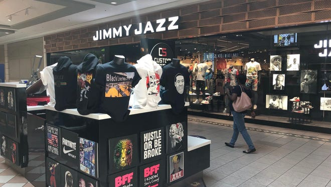 The Jimmy Jazz shoe story in Oglethorpe Mall after the incident on Sunday.