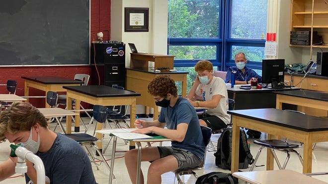 Westlake High School physics teacher Mark Misage was back on campus with a limited number of students, who were seated six feet apart, on Sept. 8.