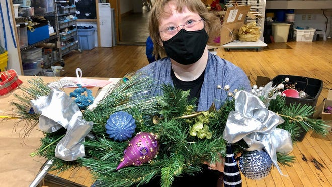 Winter arrangements are made at Holland Area Arts Council. Like many arts and culture organizations, the council has adapted to the ongoing pandemic with take-home projects, virtual tours and new safety protocol.
