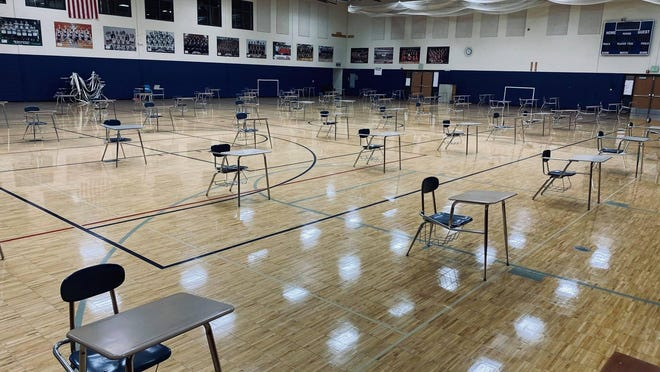 Lakewood High School has turned its gymnasium into a computer lab for students to work if they need internet access during three weeks of mandatory remote learning.