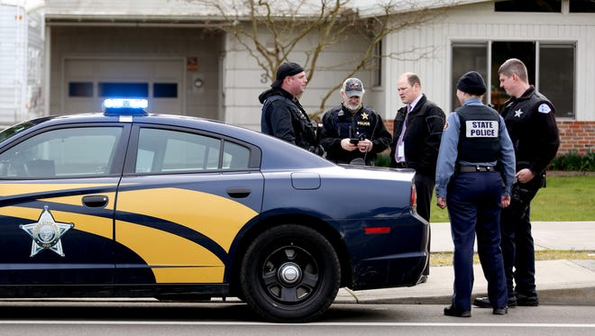 Law enforcement from multiple agencies investigate and hold a suspect at the intersection of Fisher Rd. NE and Ward Dr. NE in Salem on Tuesday, Feb. 27, 2018.