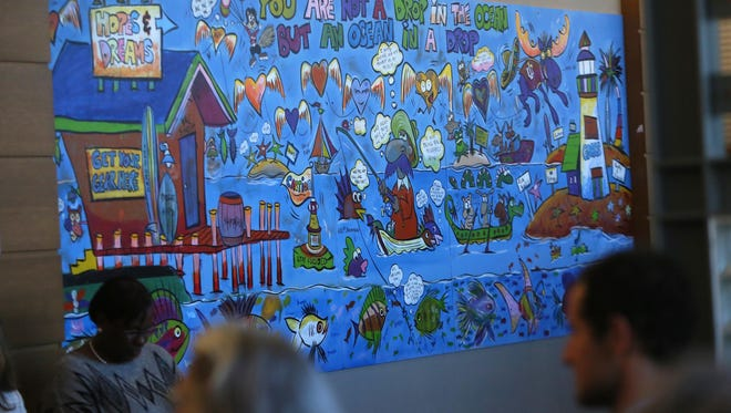 The Delaware Children's Department and the Office of Child Advocates unveil a mural in Family Court that was donated in honor of Judge Alan N. Cooper, who died last year. It was created by kids in the foster care system.