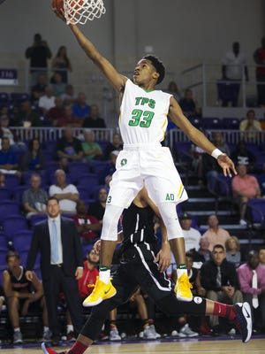 Patrick School's Al Amir Dawes scores against Sagemont during play Friday (12/16/16) at the Culligan City of Palms Classic at the Suncoast Credit Union Arena in Fort Myers. Patrick beat Sagemont 80-62.