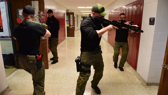 Members of a SWAT conduct an 'active shooter' drill in the hallway of a Bergen County high school.