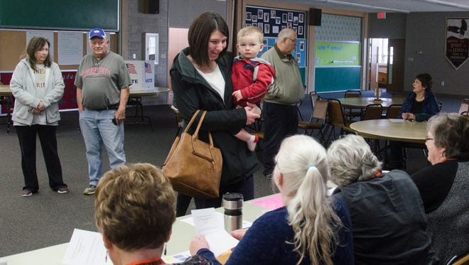 Keri LeBrun signs in to vote Tuesday, April 10, in the Dell Rapids School Board Election.