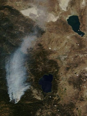 This NASA photograph from Tuesday shows smoke from the King Fire stretching past Lake Tahoe almost even to the top of Pyramid Lake.