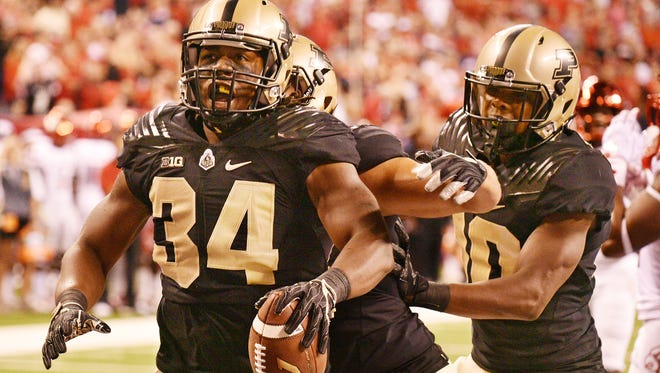 Richie Worship reacts after his touchdown with less than a minute remaining in the first half against Louisville Saturday, September 2, 2017, in Lucas Oil Stadium in Indianapolis. Worship's touchdown put the Boilermakers up 14-10 over Louisville.