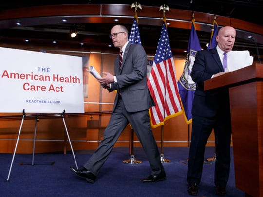 House Ways and Means Committee Chairman Rep. Kevin Brady, R-Texas, right, and House Energy and Commerce Committee Chairman Rep. Greg Walden, R-Ore., wrap up a news conference on Capitol Hill in Washington, Tuesday, March 7, 2017, as House Republicans introduce their plan to repeal and replace the Affordable Care Act.