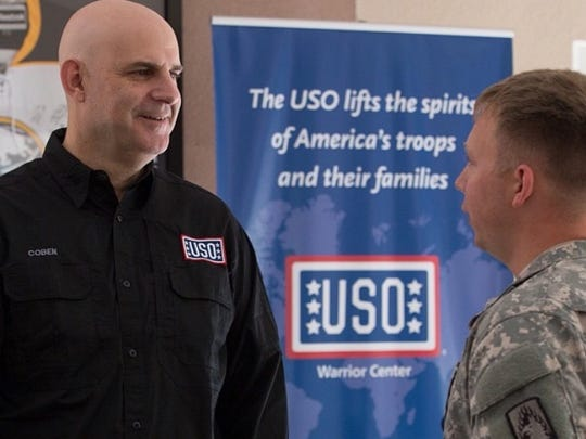 "New Jersey author Harlan Coben is shown on the USO tour during which he met the female pilot in the north of England who was inspiration for the main character in his newest novel, ""Fool Me Once."""