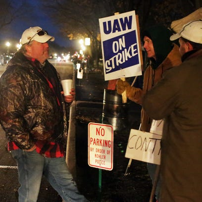 UAW Local 833 members picket along Highland Drive Tuesday