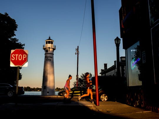 The sun sets on the recently renovated lighthouse Wednesday,