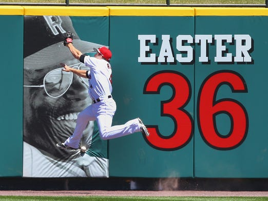 Rochester center fielder Chris Rahl crashes into the wall but cant' make the catch on a drive by Pawtucket's Carlos Rivero.