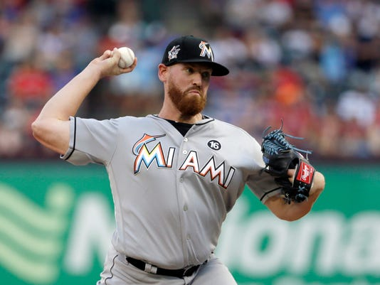 Miami Marlins' Dan Straily throws to the Texas Rangers during the first inning of a baseball game, Tuesday, July 25, 2017, in Arlington, Texas. (AP Photo/Tony Gutierrez)