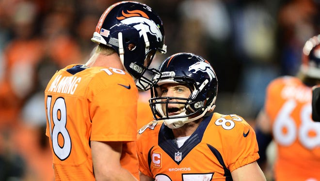 Denver Broncos wide receiver Wes Welker (83) celebrates his touchdown reception with quarterback Peyton Manning (18) in the second quarter against the Oakland Raiders at Sports Authority Field in Denver on Sept. 23, 2013.