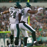 Eagles running back DeMarco Murray celebrates a first quarter touchdown with Ryan Mathews  (No. 24) during a preseason game against Baltimore.