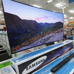 Samsung televisions are displayed at a Sam's Club store in Bentonville, Arkansas last June. Large panel makers such as LG Display and Samsung have begun reducing their inventory levels, decreasing the price of glass.