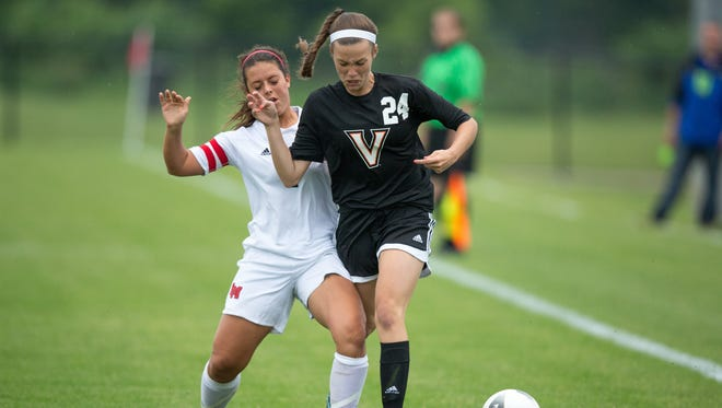 Valley High School's Haley Waseskuk gets hit by Linn-Mar's Kayla Kvach in the first half Thursday, June 11, 2015, during the IHSAA State Soccer Championships at Cownie Sports Complex in Des Moines.