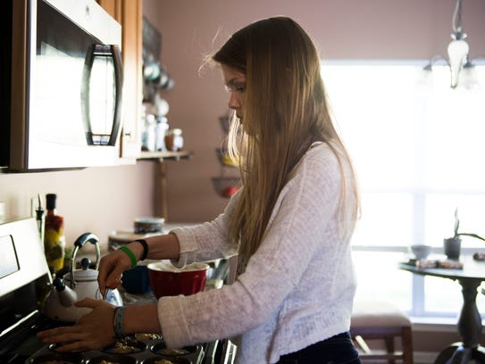 Eryn Hill bakes muffins for a party in her high school