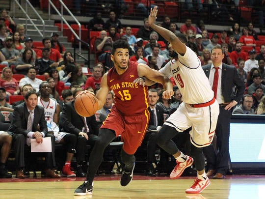 Iowa State's Naz Mitrou-Long (15) drives past Texas