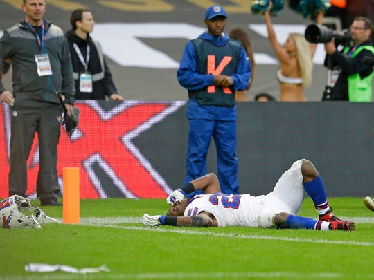 Buffalo Bills running back LeSean McCoy (25) lays on the field after a challenge in which he dropped the ball during the NFL game between Buffalo Bills and Jacksonville Jaguars at Wembley Stadium in London,  Sunday, Oct. 25, 2015.