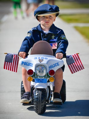In this file photo, Lachlan Thompson, 2, Annandale, took his police officer role with a bit of seriousness as he lined up for the Annandale Kiddie Parade. The parade is part of the city's weekend Fourth of July celebration.