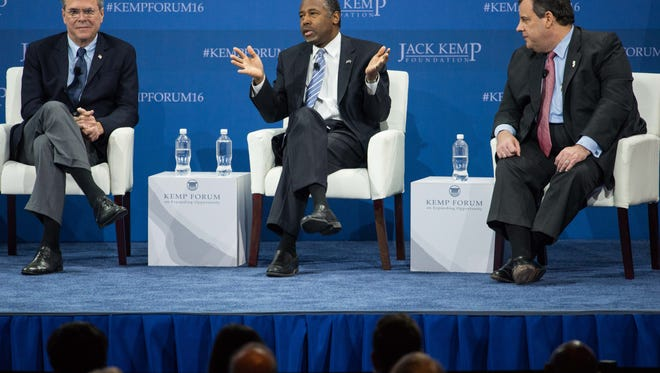 Republican presidential candidates from left, Jeb Bush, Ben Carson and New Jersey Gov. Chris Christie, right, during an economic forum, Saturday in Columbia, S.C.