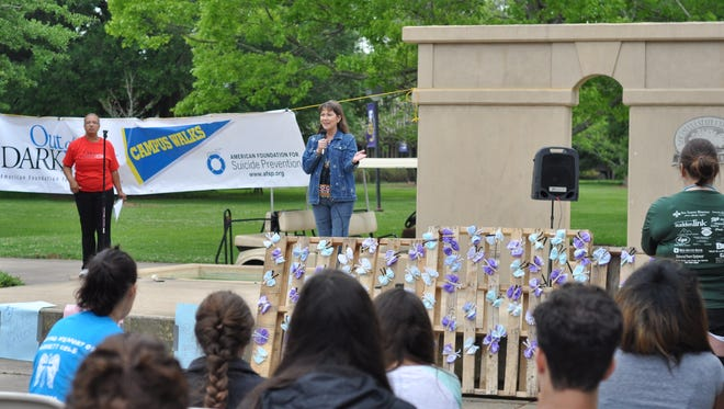 Janice Miller, counselor at Louisiana State University of Alexandria, speaks Saturday before the Out of the Darkness suicide-prevention walk on campus.