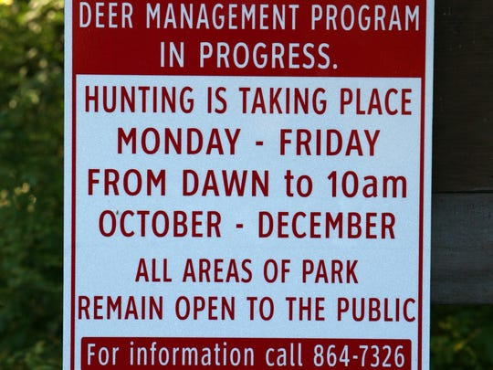 A deer management program sign is pictured on a trail at Ward Pound Ridge Reservation in September 2013.