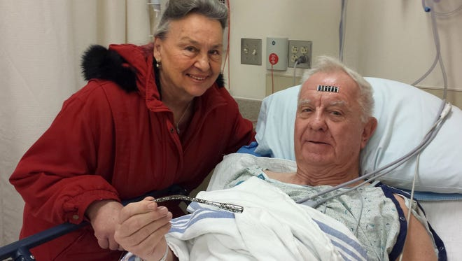 Arthur Lampitt and his wife Betty of Granite City, Mo., show off the 1963 Thunderbird turn signal that was embedded in his arm for 51 years, after having surgery to remove it on Wednesday, Dec. 31, 2014. The 7-inch turn signal was embedded in his arm during a traffic accident that broke Lampitt's hip, drawing attention away from the arm, which healed.