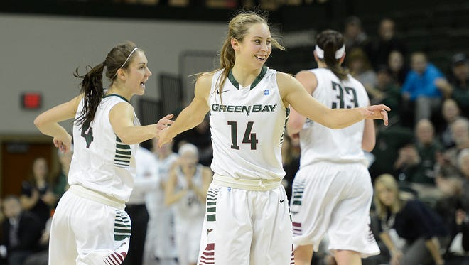UW-Green Bay's Megan Lukan (14) is all smiles after a Phoenix basket against Valparaiso during a February Horizon League game at the Kress Events Center in Green Bay.