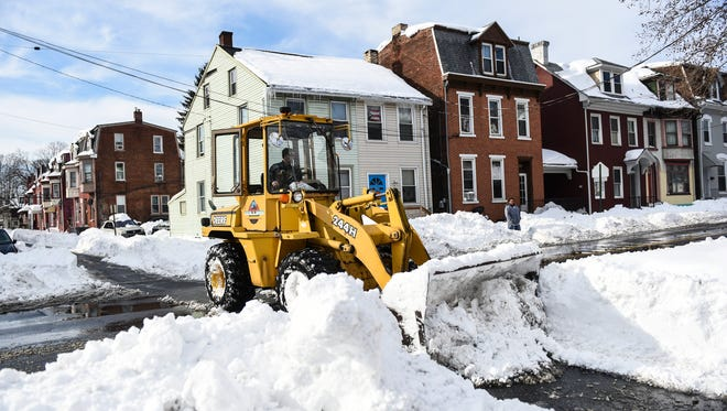A front end loader from Collins Trucking clears Church St. in Lebanon as people continued to dig out from snowstorm Jonas on Monday, Jan. 25, 2016. The snowstorm slammed Pennsylvania Friday, Jan. 22 and Saturday, Jan. 23 dropping close to 29 in. of snow on Lebanon County.
