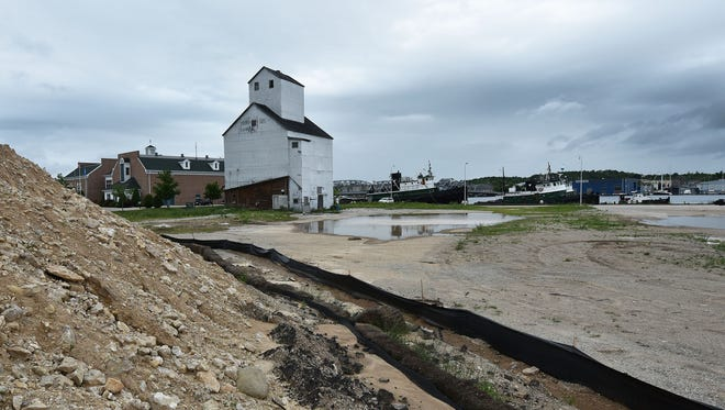 A hotel complex is proposed on the Sturgeon Bay west waterfront next to the Door County Maritime Museum in Sturgeon Bay. Several large mounds of filler occupy the land Monday that is expected to help increase the grade of the property.