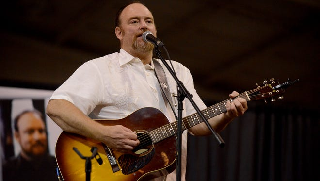 John Carter Cash performs songs by his father, Johnny Cash, during the Jackson-Madison County Library Foundation's annual fundraiser, Thursday at Jackson Fairgrounds Park.