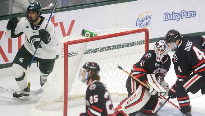 Freshman forward Patrick Khodorenko celebrates after an assist on a goal during the game against Northeastern on Sunday, Dec. 18, 2016 at Munn Ice Arena.