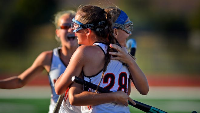Emily Kurland gets a hug from teammate Mikayla Sommer (28) after scoring Central's second goal against Dallastown, Monday, Oct. 2, 2017. The Panthers also had reason to celebrate on Thursday. Central earned the 10th-and-final District 3 Class 3-A playoff berth. John A. Pavoncello photo