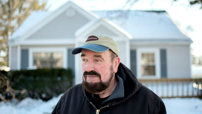 Al Chapman photographed in front of his home on Holmes Road on Wednesday, Feb. 14, 2018, in Lansing. Chapman said his neighborhood, made up of small, affordable Cape Cods and ranch houses, is solid. He worries about the negative impact that the closing of McLaren's Greenlawn campus could have on the Old Everett Area neighborhood.