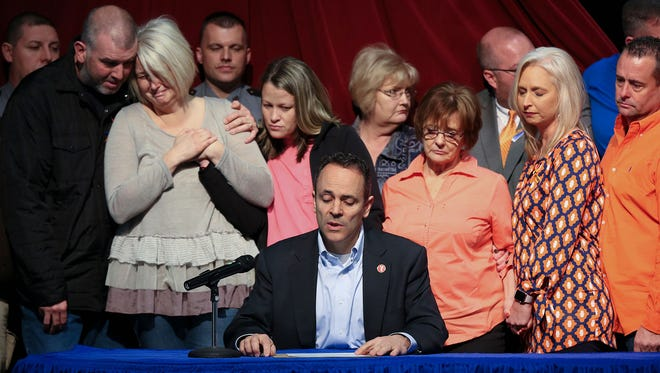Kentucky Gov. Matt Bevin, center, offered a statement of support for the victims of the Marshall County High School shooting as family members became emotional behind him. They were at the Children's Arts Center in Benton, Ky., on Jan. 26, 2018.