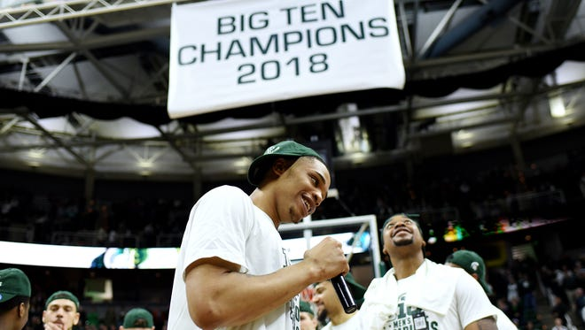 Michigan State's Miles Bridges speaks to the crowd with a Big 10 champions banner hanging above after the game on Tuesday, Feb. 20, 2018, at the Breslin Center in East Lansing. The Spartans beat Illinois 81-61.