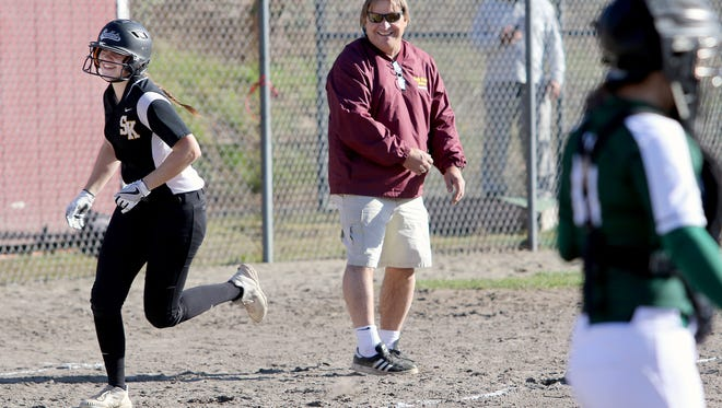 South Kitsap softball coach Paul Cermak smiles as his daughter Statia rounds third base after hitting a home run in a game against Port Angeles. Statia Cermak recently committed to the University of Nevada, Las Vegas.