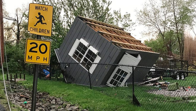 High winds blew over a shed in Lake Carmel, N.Y., on Tuesday, May 15, 2018.