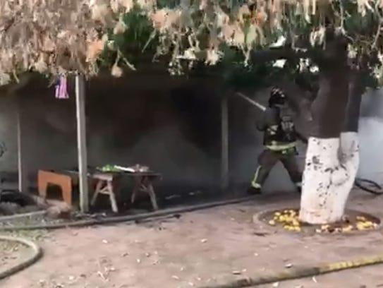 Mesa firefighters battle a basement fire at a home