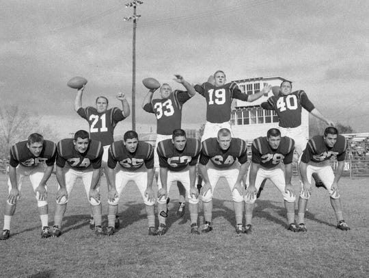 The 1958 Clemson Sugar Bowl team's starting offensive unit mugged for photos during a practice session at Biloxi High School in Biloxi, Mississippi, leading up the game.
