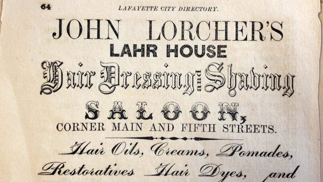 """A advertisement from the 1863 Lafayette City Directory promotes a """"Hair Dressing and Shaving Saloon"""" at the corner of Main and Fifth streets."""