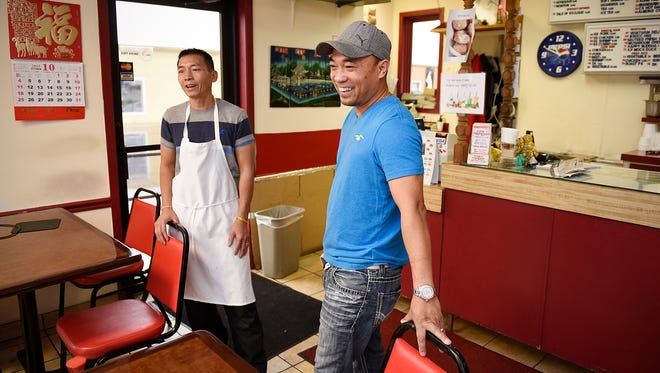 Khan Nguyen and Du Quach talk Friday about their recipes at D&K Express in St. Cloud.