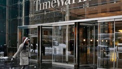 Time Warner sees earnings rise in fourth quarter.