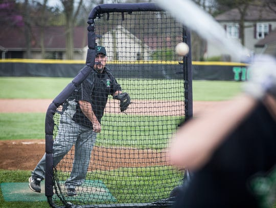 Yorktown baseball coach PJ Fauquher pitches for his