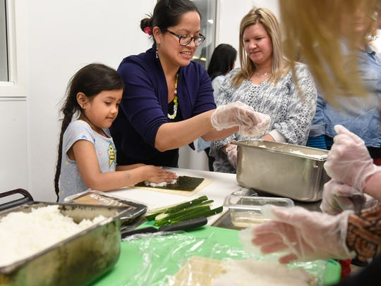 Sushi class participants prepare their own rolls Wednesday,