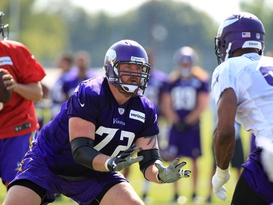 Minnesota Vikings tackle Mike Remmers (72) protects quarterback Sam Bradford (8) from defensive end Danielle Hunter (99) during NFL football training camp Friday, July 28, 2017, in Mankato, Minn. (AP Photo/Andy Clayton-King)