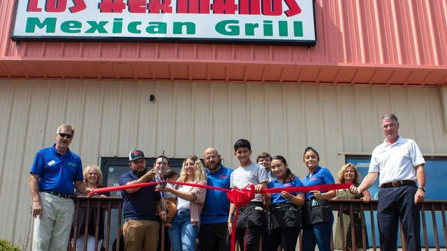 The Correa family celebrates the opening of Los Hermamos Mexican Grill in Columbia with members of the Maury County Chamber and Economic Alliance on Wednesday.